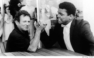 Norman Mailer arm-wrestling Mohammed Ali (actual, AP File, 1965)
