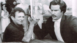 Norman Mailer arm-wrestling Ron Burgundy (from Let Me Off at the Top!)