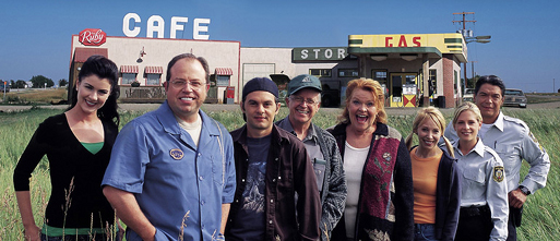 "The cast of characters in ""Corner Gas"" - left to right: Lacey, Brent, Hank, Oscar, Emma, Wanda, Sergeant Karen and Sergeant Davis."