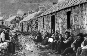 The St. Kildans outside their cottages in 1886. (Image is property of the National Trust for Scotland)