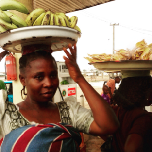 "Nigerian roadside hawker in traditional wrapper. Also called a lappa, or pagne. This is how Azaro's ""Mum"" was described."