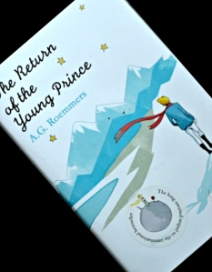 """The sticker on the front id of the iconic picture of The Little Prince on his asteroid, by Antoine de Saint-Exupéry. The text reads: """"The Long-awaited sequel to the international bestseller."""" Just goes to show - never trust a blurb."""