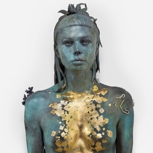 "Damien Hirst ""Aspect of Katie Ishtar ¥o-landi"", 2017, Photo by Prudence Cuming Associates. ¥o-landi/YoLandi Visser is an actress and the female vocalist in the South African zef rap group ""Die Antwoord"", famous for her white hair cut with a short fringe."
