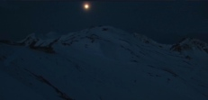 1. The image that got my attention: A cold moon over snow-covered peaks.