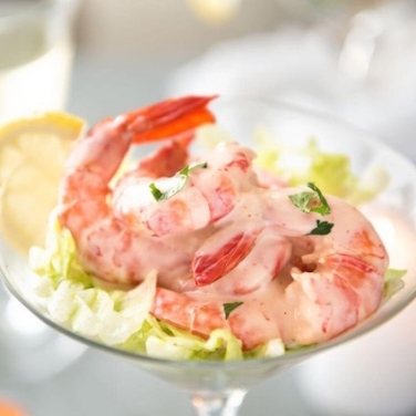 "Recognize this? It was a favourite from wedding reception menus. Coupe ""Caprice"" (literally meaning ""surprise dish"") is basically as starter of shrimp and melon in a pink sauce dressing, consisting of green peppers, red peppers, heavy cream, mayonnaise, melons, Tabasco sauce, tarragon, tomato ketchup and shrimp. The chef Robert Carrier included it in his 1963 book ""Great Dishes of the World"", which included over 550 recipes from classic clam chowder to relatively modern langoustine soup with saffron bouillon."