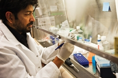 ​Researcher and oncologist Siddhartha Mukherjee works in his laboratory in the Irving Cancer Research Center at Columbia University Medical Center in New York City. Photo by Michael Weschler (Cancer Today Magazine, 31 Dec. 2014)