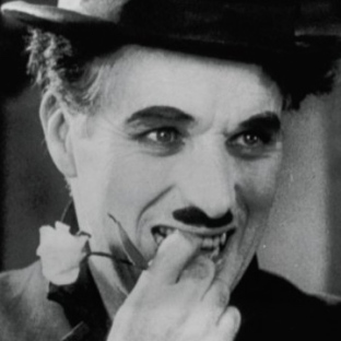"Charlie Chaplin as the Tramp in ""City Lights"" - after having just been recognized by the girl he once saved. His face shows both agony and joy."