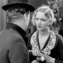 Virginia Cherrill as the blind flower seller recognizing the Tramp by his hands when she gives him a flower.