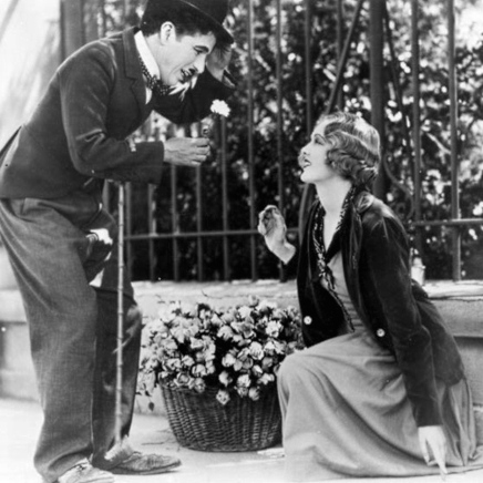 """Charlie Chaplin and Virginia Cherrill in a scene from """"City Lights"""", 1931"""