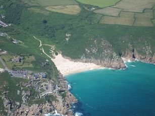 Porthcurno coast where the cables come ashore to a small building at the top of the beach. In the novel, the final scenes are played out on the beach and those towering cliffs.
