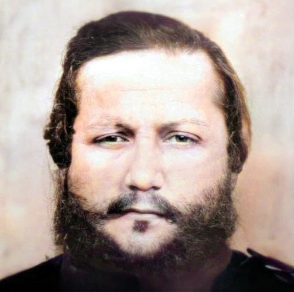 A colourized close-up of the face of FS López from the photo on the right.